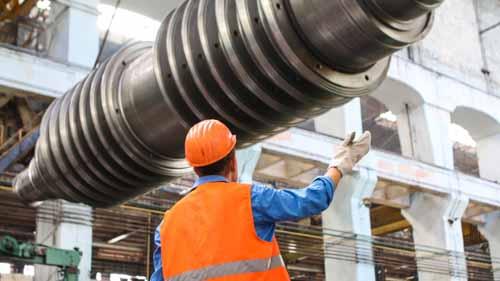 engineer checking factory equipment