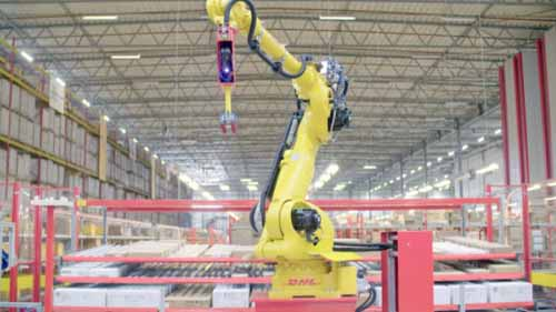 A DHL robot handling packages