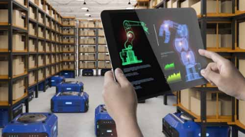 A person pointing at warehouse robots on a screen