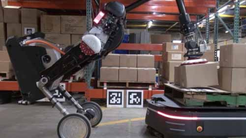 A robot loading packages in a warehouse