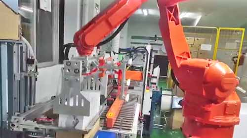 Robot arm packaging items.