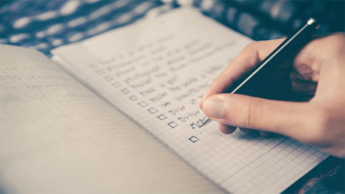 A person creating a checklist