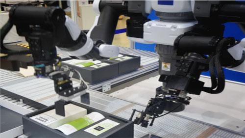 Robotic arms at work.