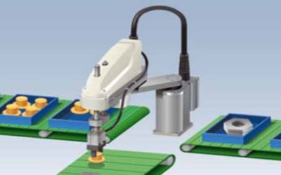 A scara robot lifting small knobs