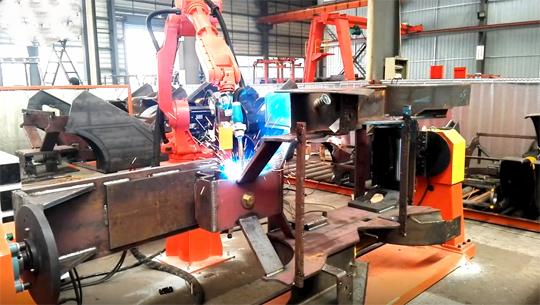 Welding robot working in a toolroom